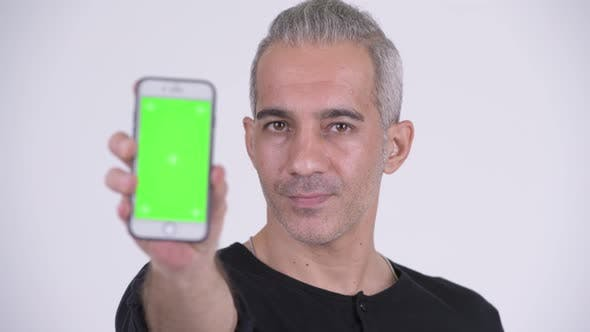 Happy Handsome Persian Man Showing Phone