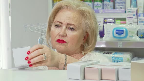 Thumbnail for Senior Elegant Lady Shopping for Cosmetic Products at Drugstore