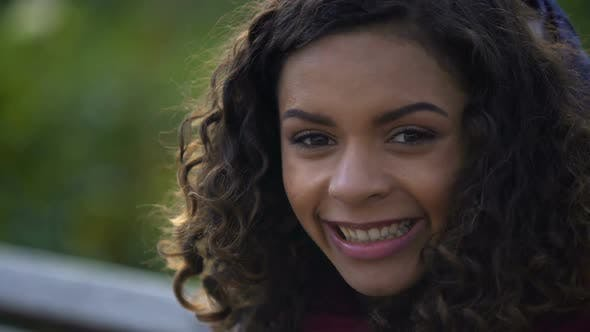 Thumbnail for Beautiful Biracial Woman Posing for Camera and Smiling Sincerely, Face Close-Up