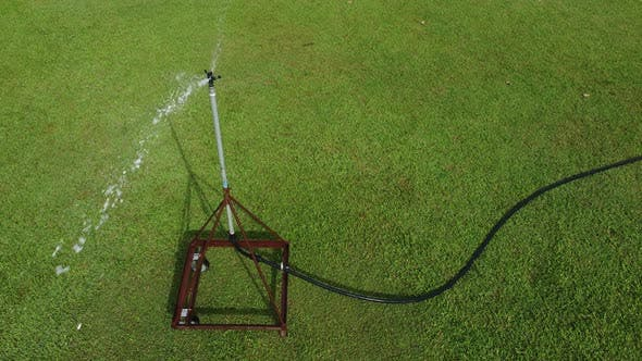 Water is spray and rotate to watering the grass