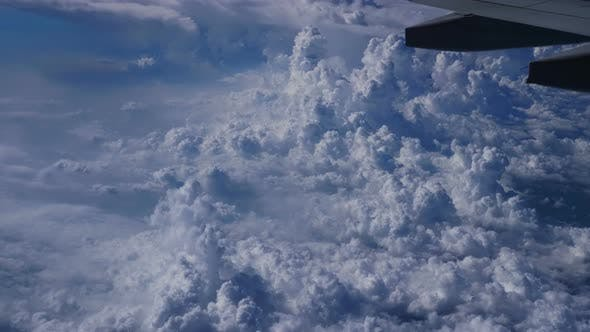 Thumbnail for Airplane Flying Over Clouds