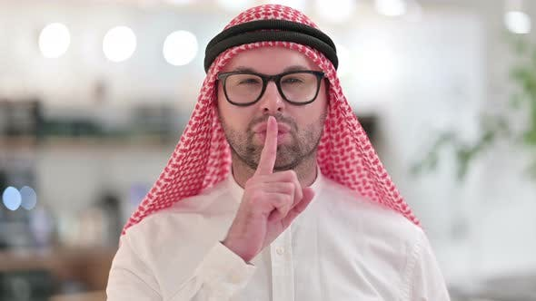 Thumbnail for Young Arab Businessman Putting Finger on Lips