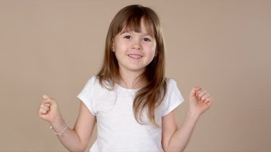 Thumbnail for Cute Little Girl in White Tshirt Dancing, Smiling and Having Fun in Studio Session