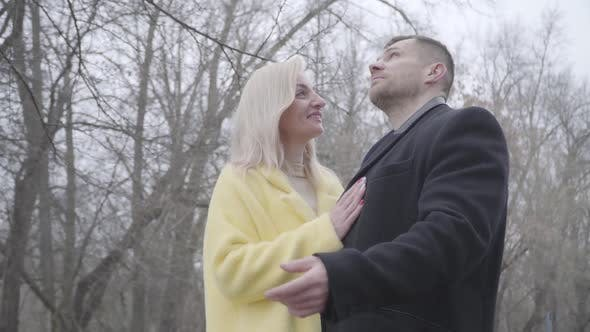 Thumbnail for Beautiful Blond Caucasian Woman and Brunette Man Dating in Park in Cloudy Day