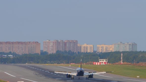 Jet Airplane Touches the Runway When Landing