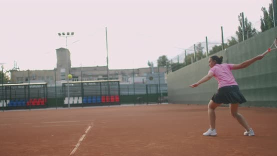 Thumbnail for Female Tennis Player in Action During Game on the Professional Stadium. She Is Wearing Unbranded