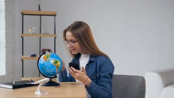 Thumbnail for Handsome Young Woman in Glasses Looking to the Globe