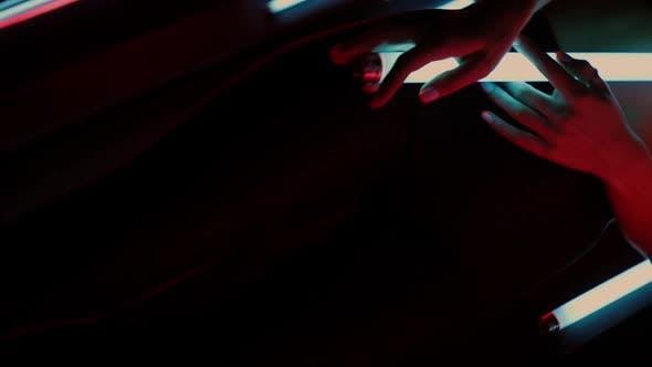 Sensual Woman Under Neon Illumination