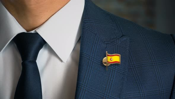 Thumbnail for Businessman Walking Towards Camera With Country Flag Pin Spain