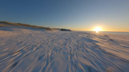 Bright Sky and Beautiful Snowy Terrain By the Sea Shore  Drone FPV