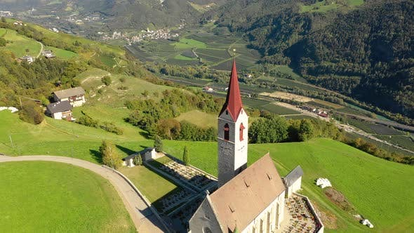 Cover Image for A Bird's-eye View of the Church and the Valley Near the Village of Velturno. Dolomites. Autumn Italy