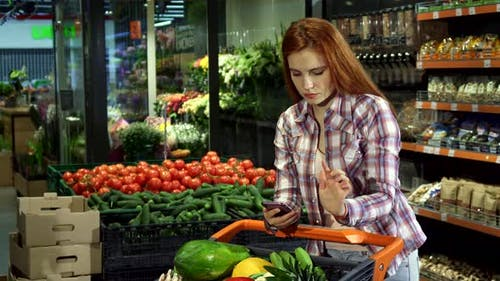 Couple Checks Their Purchases According To the Shopping List