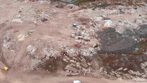 Thumbnail for Garbage dump. Bulldozer is pushing debris on field. Construction waste