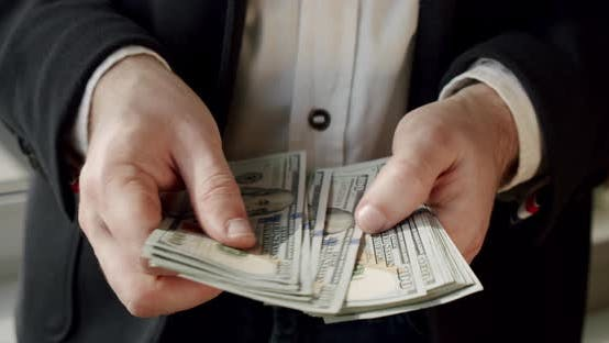 Thumbnail for Businessman Scatters Dollars