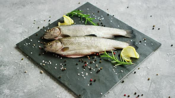 Thumbnail for Spices and Lemon Lying Near Uncooked Fish
