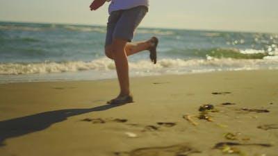 Barefoot legs running on sand