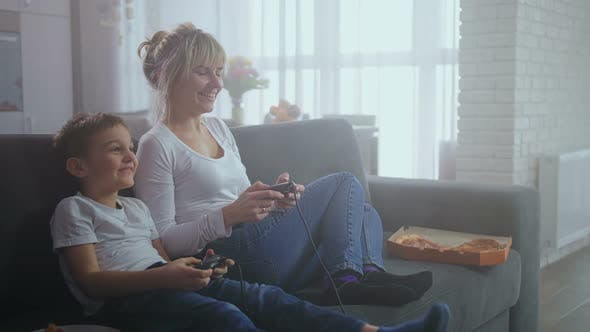 Thumbnail for Joyful Mother and Son Playing Video Game at Home