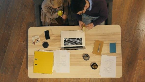 Workers enjoying lunch break in the office