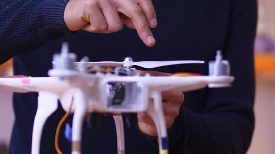 Male Hands Mount the Propeller on the Drone
