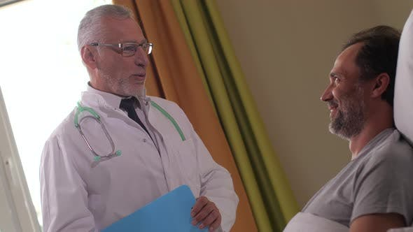 Cover Image for Happy Patient Hearing Good News From Physician