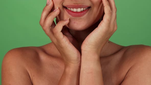 Thumbnail for Stunning Happy Woman Smiling and Cupping Her Face with Her Hands