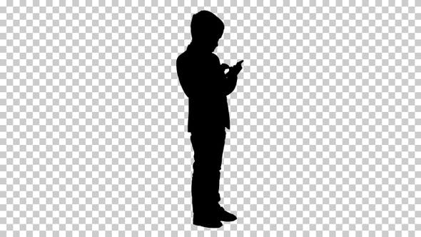 Thumbnail for Silhouette Young boy in elegance suit playing with mobile