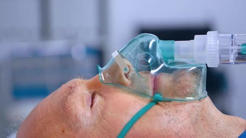 Close Up of Old Man Breathing with Difficulties