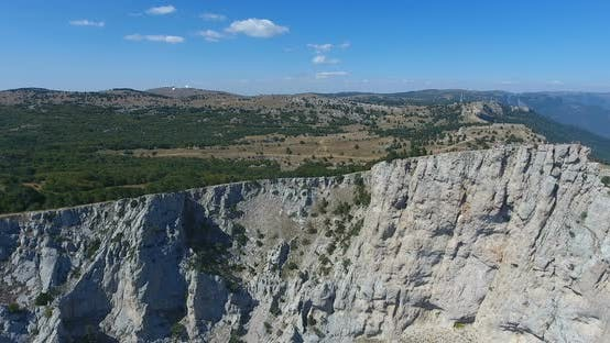 Drone Shot Flying Close To a Huge Rock Cliff. Aerial View on Crimea Landscape with Cliffs and