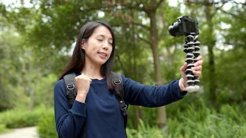 Woman record vlog on camera