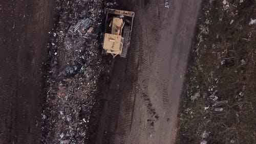 Bulldozer Piling Up Garbage