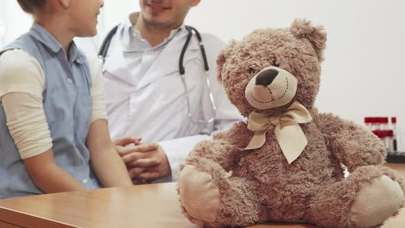 Thumbnail for During the Reception of the Girl at the Doctor, on the Table Sits a Small Teddy Bear