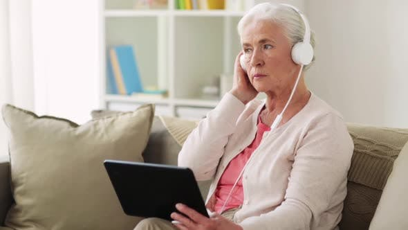 Thumbnail for Senior Woman with Tablet Pc and Headphones at Home