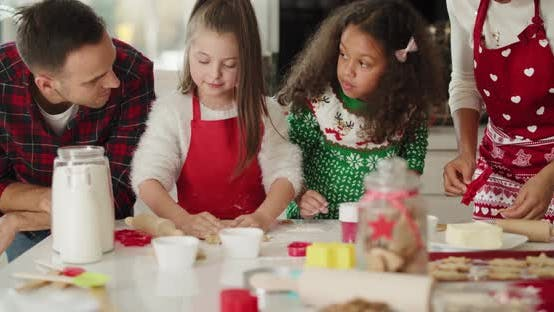 Thumbnail for Family preparing christmas cookies in the kitchen