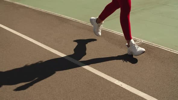 Thumbnail for Closeup Female Feet Jogging in Trainers on Track, Girl Running Outdoors on Track