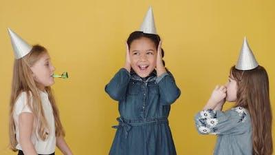 Kids with Birthday Cake Celebrating Birthday Copy Space Orange Background