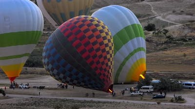 Preparations for Inflating Hot Air Balloons at Morning