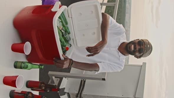 African-American Man Posing on Rooftop Terrace