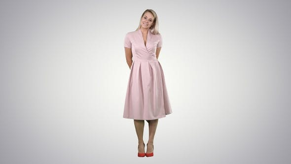 Thumbnail for Happy beautiful woman in pink dress posing on gradient background
