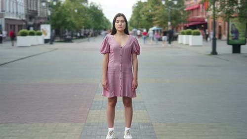 Time Lapse of Beautiful Asian Lady Standing Outside in Pedestrian Street on Summer Day