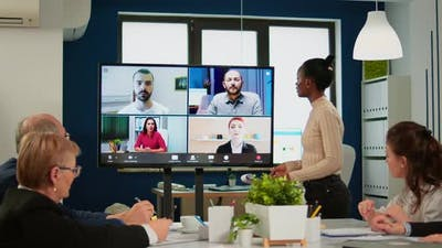 Black Manager Woman Talking with Remotely Colleagues on Video Call