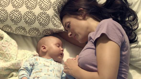 Thumbnail for Baby and mother in bed