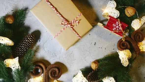 Good Winter Mood Awaiting Christmas. Human Hands Put a Christmas Present To the Rest of the