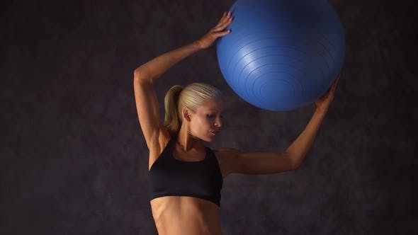 Thumbnail for Woman exercising with ball