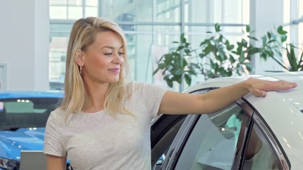 Happy Beautiful Female Driver Showing Car Keys To Ker New Automobile