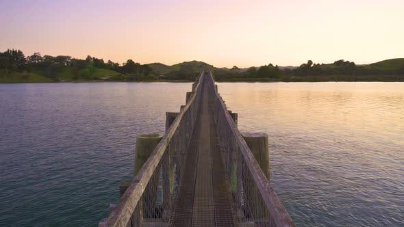 Thumbnail for Colorful Evening in Wooden Bridge over Ocean Bay in New Zealand Nature
