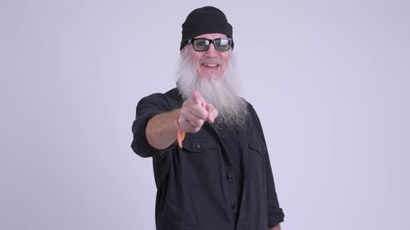 Cover Image for Happy Mature Bearded Hipster Man Pointing at Camera