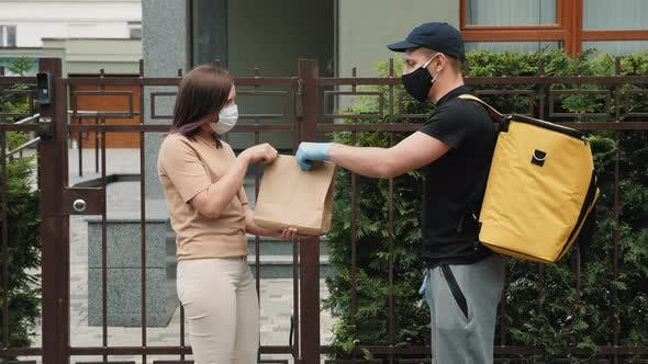 Courier Delivers Takeaway Paper Bag with Food To Girl