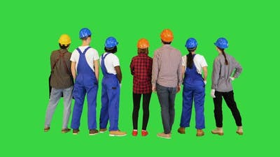 Group of Contractors People in Uniform Looking at Their Work on a Green Screen Chroma Key