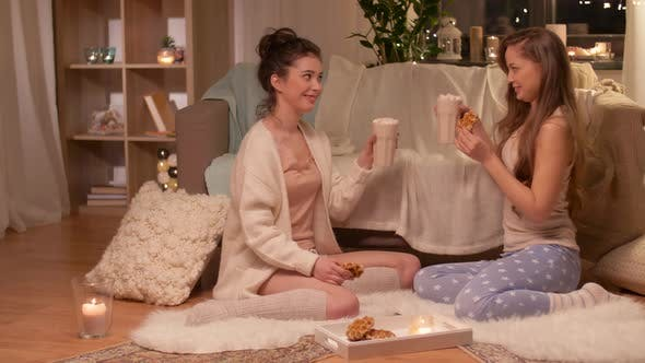 Cover Image for Teenage Girls Drinking Hot Chocolate at Home