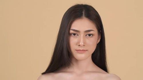Beautiful woman present face skin